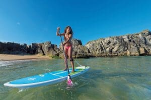 a picture of a girl on an ace tech paddle board