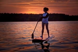 woman sunset paddle boarding