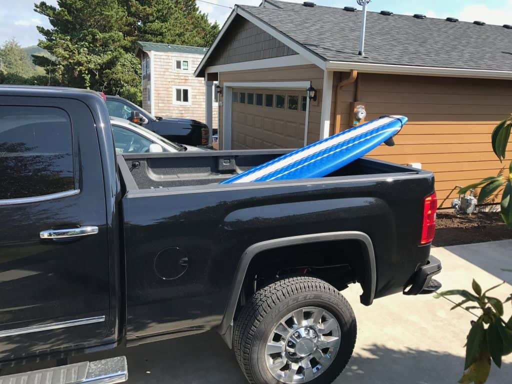 a picture of a wavestorm paddle board in the bed of a truck