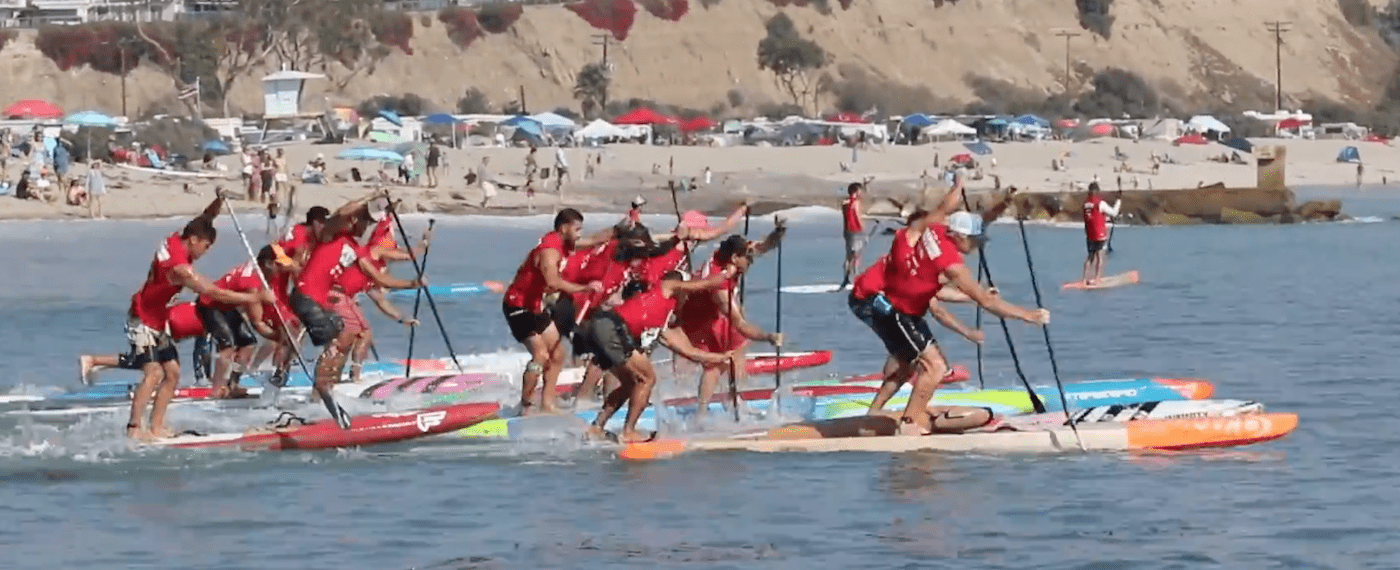 a picture of stand up paddle board racing